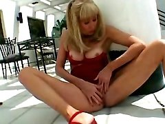 Old lady in red masturbates outdoor